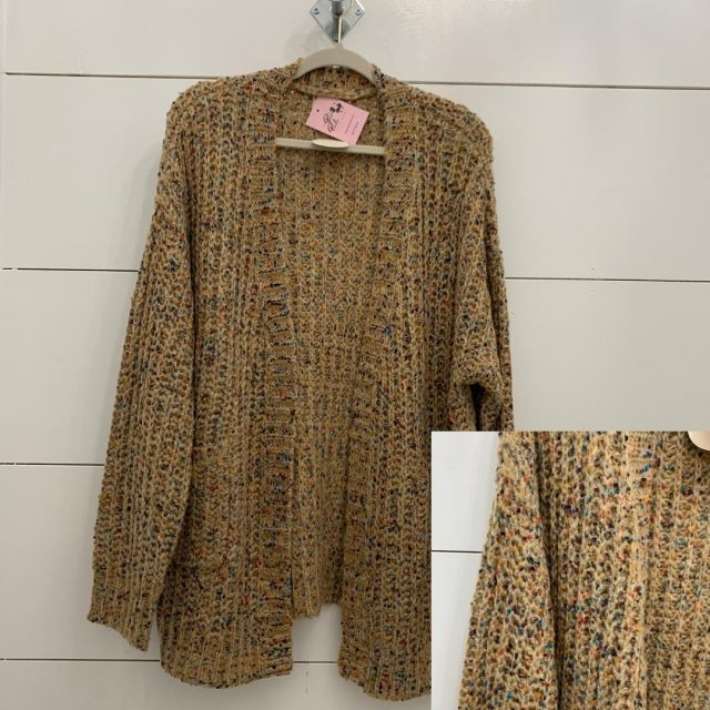 This sweater has been one of our best sellers! We've included a close-up swatch so you can see all the wonderful colors! This super-comfy sweater goes with EVERYTHING. Come grab it before we close at 4 PM!